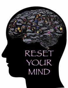 Illustration montrant la tête, le contour du cerveau et l'inscription : reset your mind